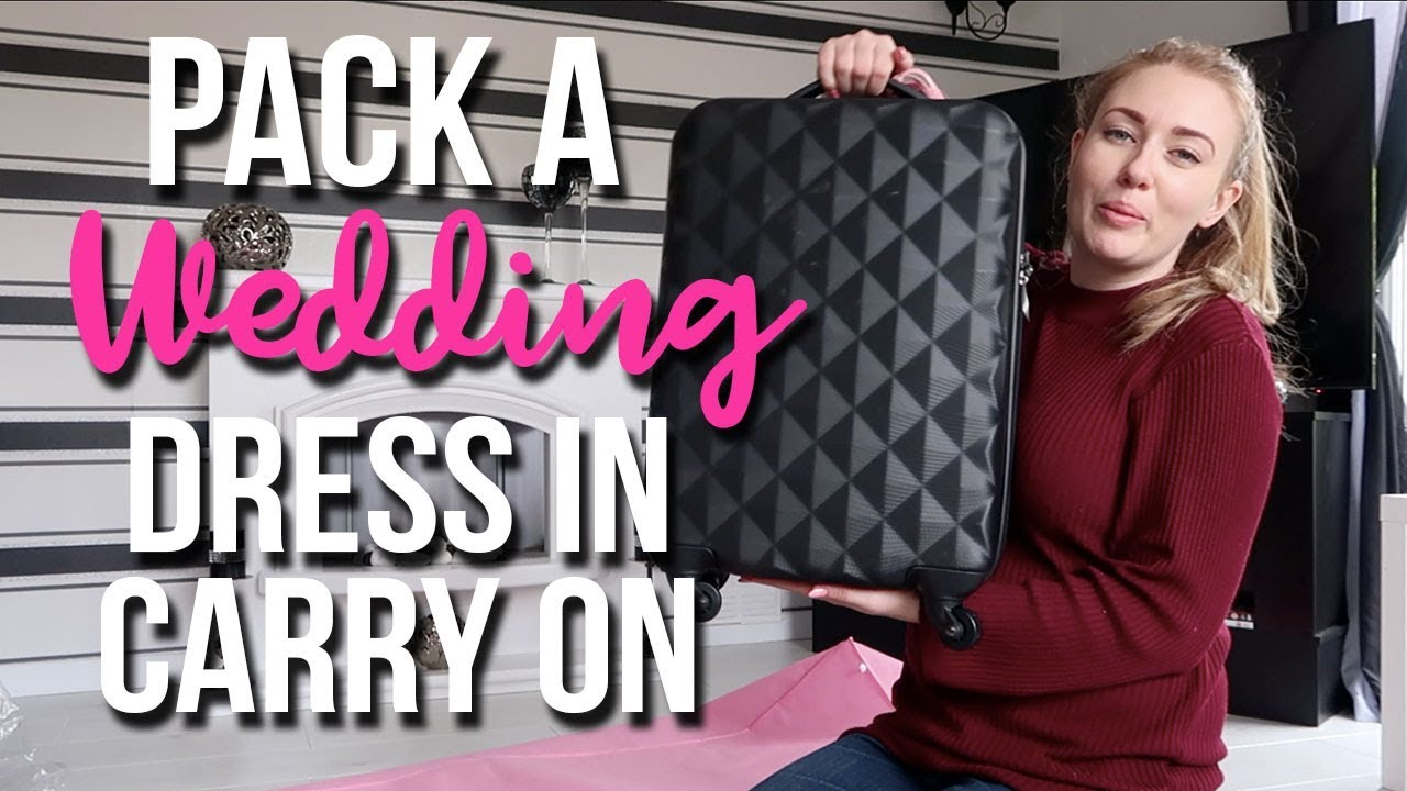 HOW TO PACK A BALLGOWN WEDDING DRESS INTO CARRY ON HAND LUGAGE - A CHILDMINDING MUMMY